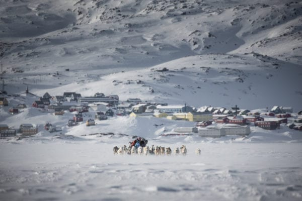 A-dog-sled-leaving-Tasiilaq-in-East-Greenland