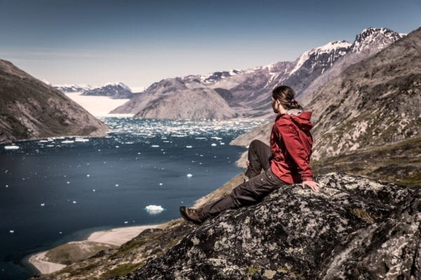 A hiker overlooking Qooroq ice fjord in South Greenland near Narsarsuaq
