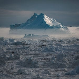 An-iceberg-in-mist-at-sunset-in-the-Ilulissat-ice-fjord-in-Greenland
